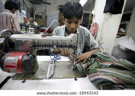 Delhi, India - Feb 2008. Young worker in a small factory in Old Delhi. Contributing  to India's growing economy.