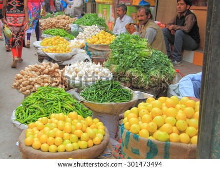 DELHI, INDIA - FEBRUARY 20, 2015: man sells vegetables in the market of Delhi, India