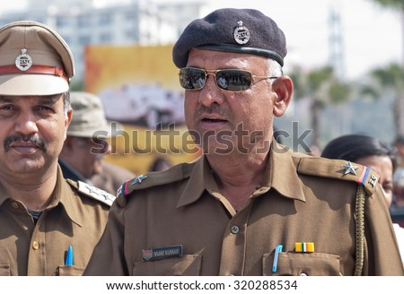 Delhi, India - February 13, 2015: two indian policemen in uniform close up image at annual Surajkund Fair on the outskirts of Delhi in India - stock photo