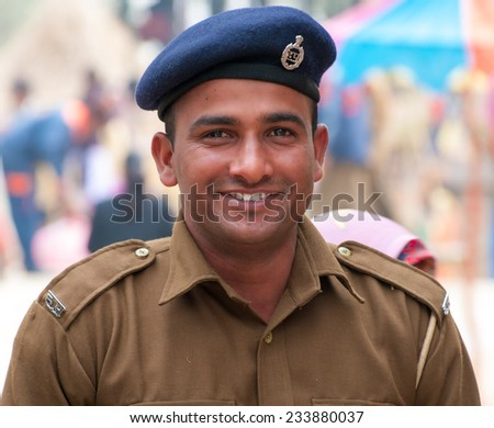 Delhi, India - February 4, 2012: Unidentified smiling policeman at annual Surajkund Fair on the outskirts of Delhi in India