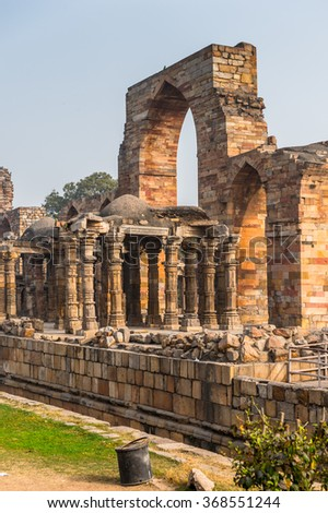 DELHI, INDIA - JAN 18, 2016: Qutb Mosque Arch Ruin at the Qutb complex (Qutub),  an array of monuments and buildings in Delhi, India. UNESCO World Heritage Site