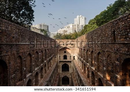 DELHI, INDIA - JANUARY 4, 2015: Agrasen ki Baoli on January 4, 2015 in Delhi, India. Agrasen ki Baoli is a step well and is believed it was built during the Mahabharat epic era. - stock photo