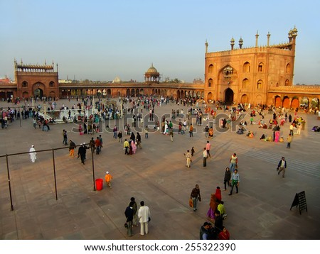 DELHI, INDIA - JANUARY 23: Unidentified people walk in the courtyard of Jama Masjid at sunset on January 23, 2011 in Delhi, India. Courtyard of mosque can hold up to twenty-five thousand worshippers.