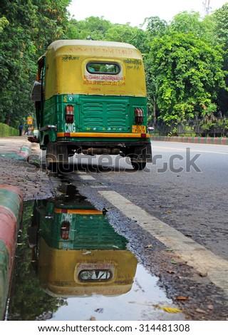 DELHI, INDIA - JULY 20, 2015: Auto rickshaw, called Tuk Tuk, is popular mode in Delhi, India. JULY 20 2015 - stock photo