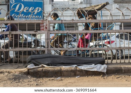 DELHI INDIA - MAR 21 : tramp man sleep on street at chandni chowk in old delhi, tramp person live everywhere in public place in Delhi on march, 21, 2015, india - stock photo