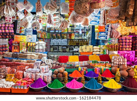 DELHI, INDIA - MARCH 26: Indian shop on March 26, 2012, Delhi, India. Small shops like this are the most common in poor region of Delhi. Tourists can see the color of India in them. - stock photo