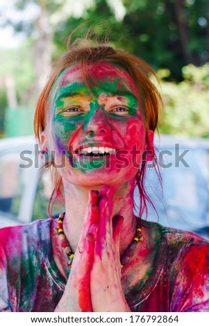 DELHI, INDIA - MARCH 20: Tourist with students of Jawaharlal Nehru University celebrate festival Holi on March 20, 2011 in Delhi, India. Holi is a spring festival celebrated as a festival of colours. - stock photo
