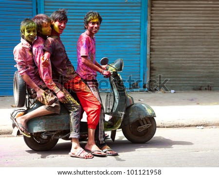 DELHI, INDIA - MARCH 08: unidentified People covered in paint on Holi festival, March 08, 2012, Delhi, India. Holi, the festival of colors, marks the arrival of spring, being one of the biggest festivals in India - stock photo