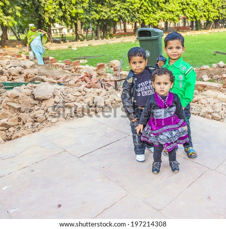 DELHI, INDIA - NOV 9, 2011: group of indian children pose in Delhi, India. Average about 1 child or two children is the norm in most Indian Hindu families. The fertility rate for Indian women is 2.7. - stock photo