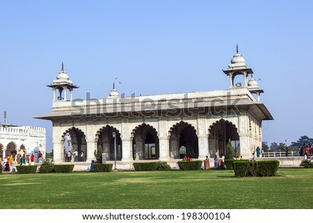 DELHI, INDIA - NOV 11, 2011: Local people spend their leisure time in the afternoon, before the Diwan-i-Khas, the white building in Red Fort, Delhi, India. - stock photo
