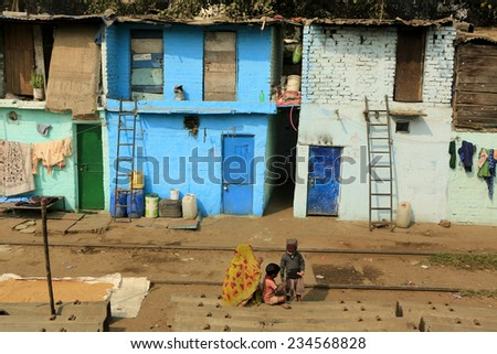DELHI,INDIA - November 13,2014 : Ghetto and slums in Delhi India.These unidentified people live in  avery  difficult conditions on the ghettos of the city.