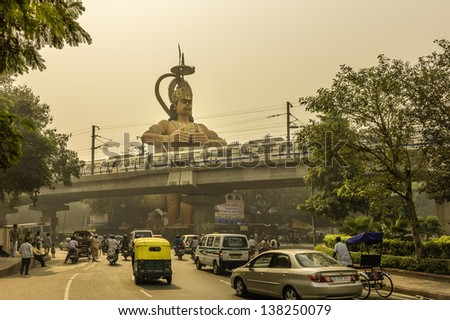 DELHI, INDIA - OCTOBER 20: View of the giant Hanuman, Monkey God, temple overlooking the Metro and traffic on October 20, 2011 at Karol Bagh, New Delhi, India.