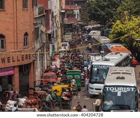 DELHI, INDIA - 19TH MARCH 2016: Long queues of traffic in central Delhi during the day. Buses, Rickshaws, other vehicles and people can be seen. - stock photo