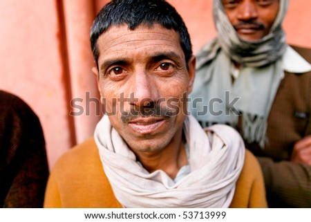 DELHI - JAN 31: Portrait of a day labourer January 31, 2008 in Delhi, India. These men sit on the street hoping to get day jobs not paid more than 2,5 dollars a day. - stock photo