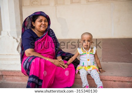 DELHI, RAJASTAN / INDIA - JUNE 02 2013 - Indian woman and her daughter at the street. - stock photo