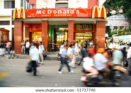 DELHI - SEPTEMBER 15: Crowds passing in front of McDonald's on September 15, 2007 in Delhi, India. It's the only country in the world that does not offer beef on its menu. - stock photo