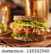 deli meat sandwich with turkey close up shot with selective focus - stock photo