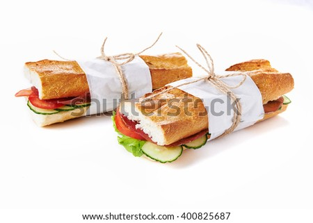 deli sandwiches in paper wrap  isolated on white
