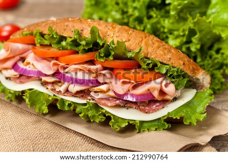 Deli sub sandwich. Selective focus. - stock photo