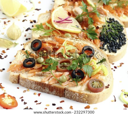 Delicacy appetizer with smoked salmon and vegetables - stock photo