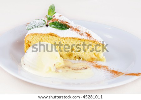 Delicate apple sponge cake with mint and vanilla ice cream
