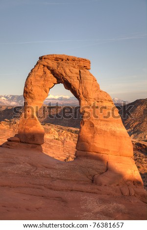 Delicate Arch at sunset in Arches National Park - stock photo