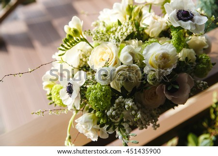 Delicate bouquet made of white roses, pionies and ranunculus