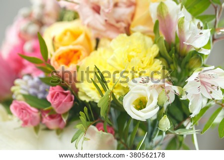 delicate bouquet of bright flowers isolated on white - stock photo