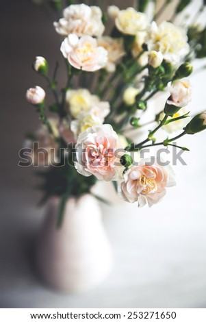 delicate bouquet of carnations in a vase vintage. romance. Flowers - stock photo