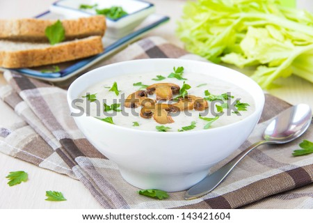 Delicate cheese cream soup with mushrooms and vegetables