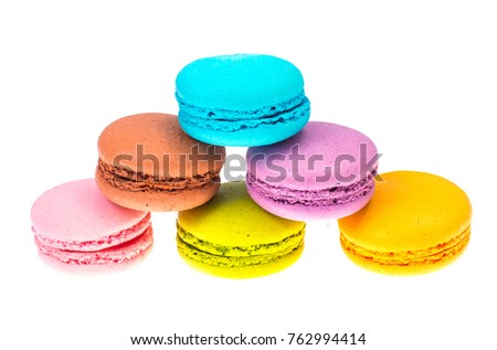 Delicate delightful delicious colored macaroons on white background. Studio Photo