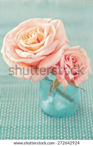 Delicate pink roses in a glass vase (vintage style)  - stock photo