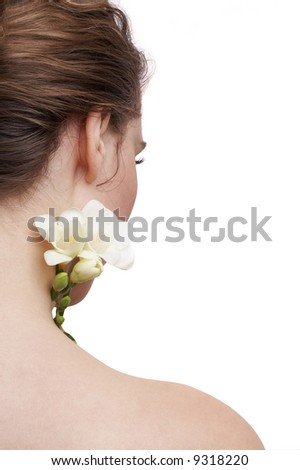 delicate skin, the back of a woman and white flower, spa treatment