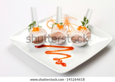 Delicate Steamed Chinese Prawn Dumpling In Rice Flour On Porcelain Spoon