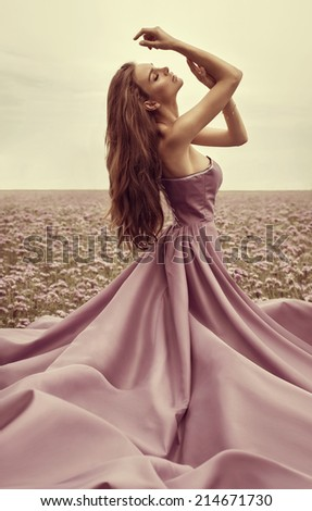 Delicate woman in pink dress  - stock photo