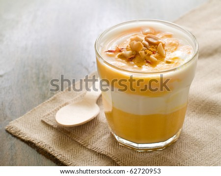 Delicious and creamy pumpkin soup in glass - stock photo