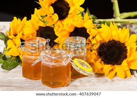 Delicious and fresh honey with colorful sunflowers