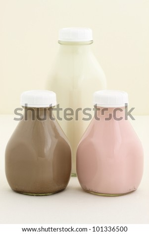 Delicious and fresh Strawberry, chocolate and regular milk bottles made with organic real fruit, chocolate mass and regular milk - stock photo