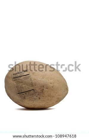 Delicious and freshly picked natural organic cantaloupe with a nutrition label - stock photo