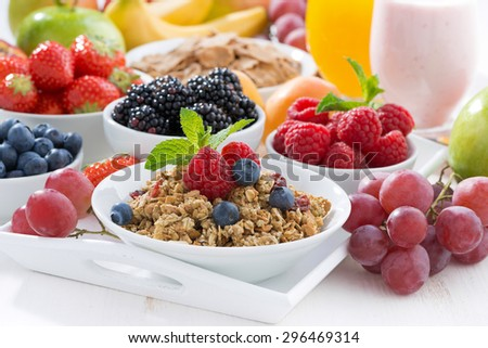 Delicious and healthy breakfast with fruits, berries and cereal, horizontal - stock photo