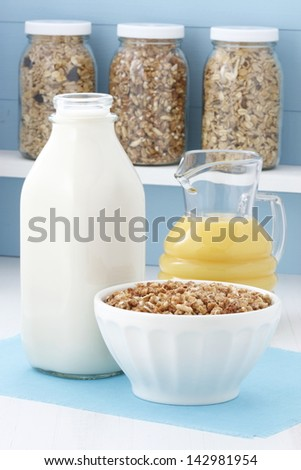 Delicious and healthy crunchy oats cereal, popular around the world, and often eaten in combination with yogurt or milk. - stock photo