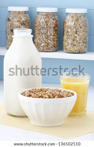 Delicious and healthy crunchy oats cereal with milk and orange juice. - stock photo