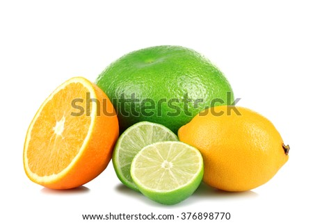 delicious and healthy, whole and cut into pieces the citrus fruit isolated on white background lie in a heap - stock photo