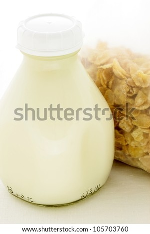 Delicious and nutritious corn flakes and healthy Pint Glass Milk Bottle. - stock photo