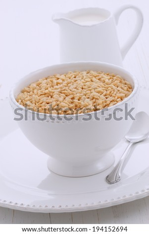 Delicious and nutritious crisped rice cereal, served in a beautiful vintage bowl - stock photo