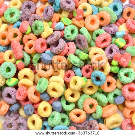 Delicious and nutritious fruit cereal flavorful, healthy and funny addition to kids breakfast on background - stock photo