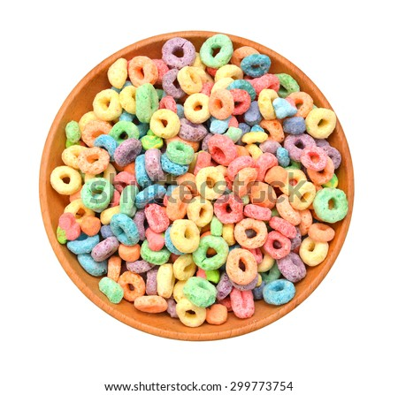 Delicious and nutritious fruit cereal loops flavorful in wooden bowl on white background - stock photo