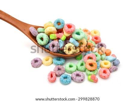 Delicious and nutritious fruit cereal loops flavorful in wooden spoon on white background, healthy and funny addition to kids breakfast  - stock photo