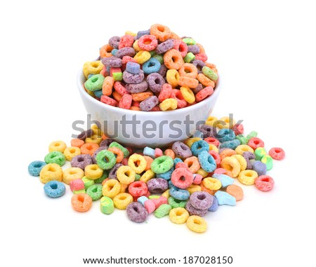 Delicious and nutritious fruit cereal loops flavorful on white background, healthy and funny addition to kids breakfast  - stock photo