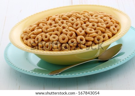 Delicious and nutritious lightly toasted honey, nuts and oats cereal with milk. - stock photo